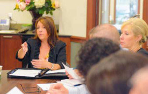 Jill McKibbin of McKibbin Consulting and founder of the Commercial, Industrial, Service Trade Group talks to members of the  new CIST North chapter during a meeting May 6 at Farmers National Bank in Cranberry Township.